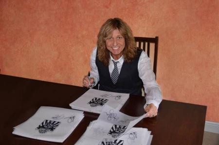 David Coverdale signing the California Jam limited edition book